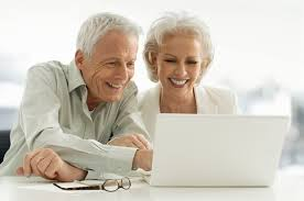 Senior couple viewing insurance rates