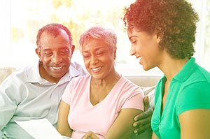 Elderly couple talking with financial advisor